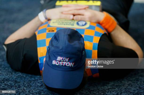 A charity runner for Children's Hospital relaxes inside the masonic Lodge in downtown Hopkinton Mass on April 17 ahead of the 121st Boston Marathon
