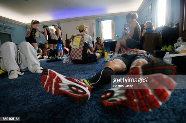 Charity runners for Children's Hospital relax inside the Masonic Lodge in downtown Hopkinton Mass on April 2017 ahead of the 121st Boston Marathon