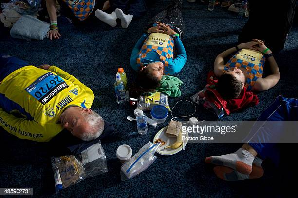 Charity runners for Children's Hospital relax Marathon at the Masonic Lodge in downtown Hopkinton before the start of the 118th Boston Marathon on...