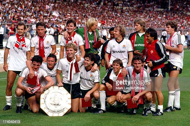 Charity Shield Liverpool v Manchester United United pose for a group photo with the Charity Shield