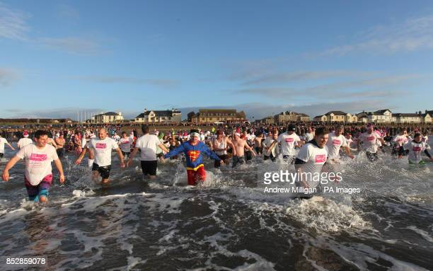 Charity swimmers take a dip in the sea at Prestwick Beach to raise money for childrens charity Clic Sargent