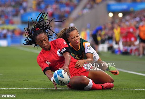 Charity Williams of Canada holds off Mathrin Simmers of South Africa to score a try during the Rugby Sevens Women's Pool A match between Canada and...