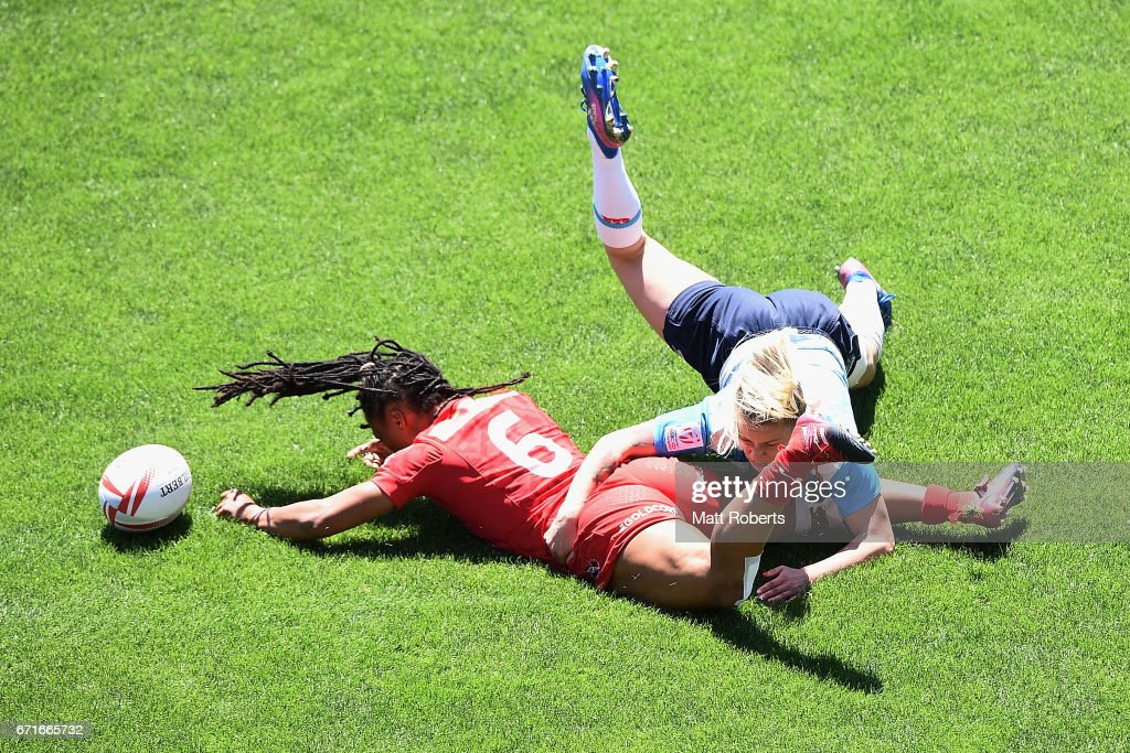Charity Williams of Canada is tackled by Daria Bobkova of Russia during the HSBC World Rugby Women's Sevens Series 2016/17 Kitakyushu quarter final between Canada and Russia at Kitakyushu Stadium on April 23, 2017 in Kitakyushu, Japan.