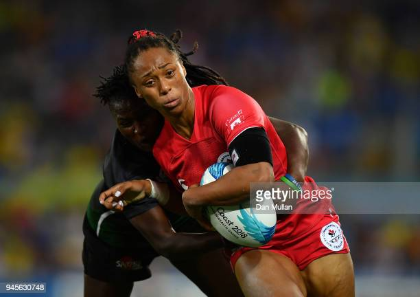 Charity Williams of Canada is tackled by Janet Okelo of Kenya during the Rugby Sevens Women's Pool A match between Canada and Kenya on day nine of...