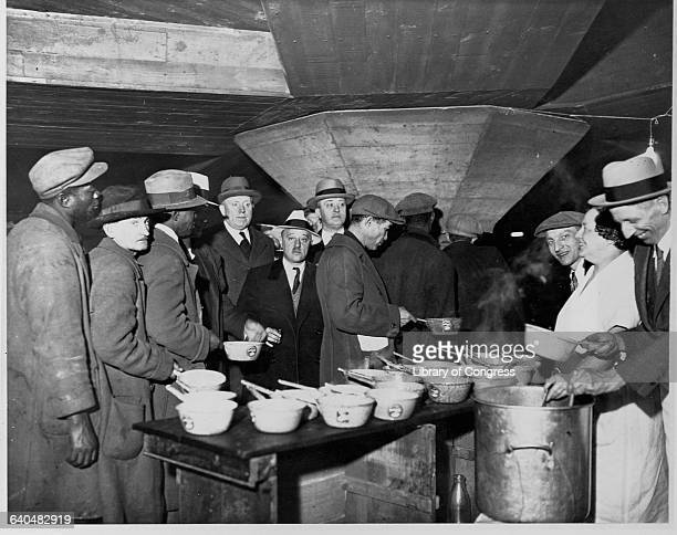 Charity workers serve soup to unemployed men at the lower level of Wacker Drive in Chicago Illinois