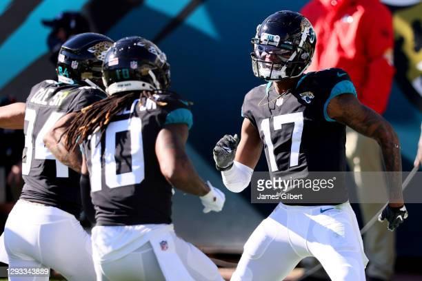 Chark Jr. #17 of the Jacksonville Jaguars celebrates with Laviska Shenault Jr. #10 and Keelan Cole Sr. #84 after scoring a touchdown against the...