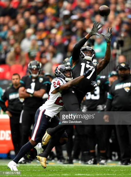 Chark Jr Jacksonville Jaguars attempts to take a catch as Johnathan Joseph of Houston Texans tackles during the NFL game between Houston Texans and...