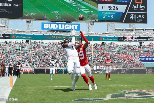 J Chark of the Jacksonville Jaguars catches a pass for a touchdown against Kendall Fuller of the Kansas City Chiefs during the first quarter at TIAA...