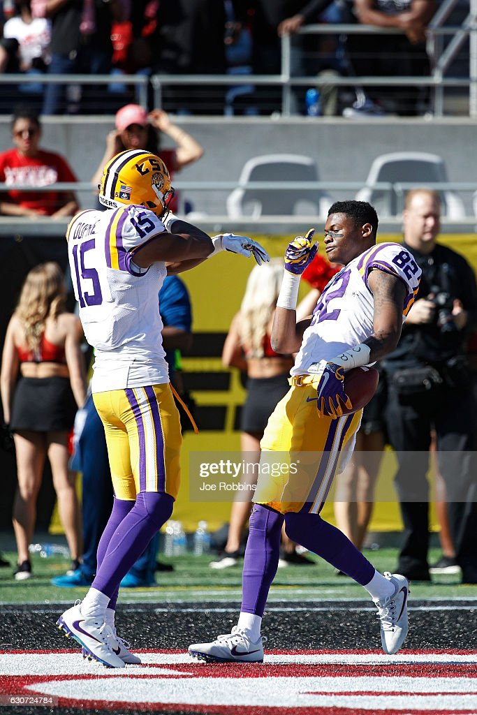 D.J. Chark #82 of the LSU Tigers celebrates with Malachi Dupre #15 after a 39-yard reception against the Louisville Cardinals to set up a touchdown in the second quarter of the Buffalo Wild Wings Citrus Bowl at Camping World Stadium on December 31, 2016 in Orlando, Florida.