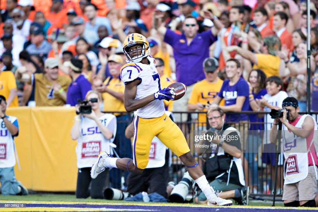 DJ Chark #7 of the LSU Tigers returns a punt for a touchdown in the second half against the Auburn Tigers at Tiger Stadium on October 14, 2017 in Baton Rouge, Louisiana. The LSU defeated the Auburn 27-23.