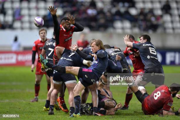 Charl McLeod of Stade Francais kicks the ball during the European Rugby Challenge Cup match between Stade Francais and Edinburgh at Stade JeanBouin...