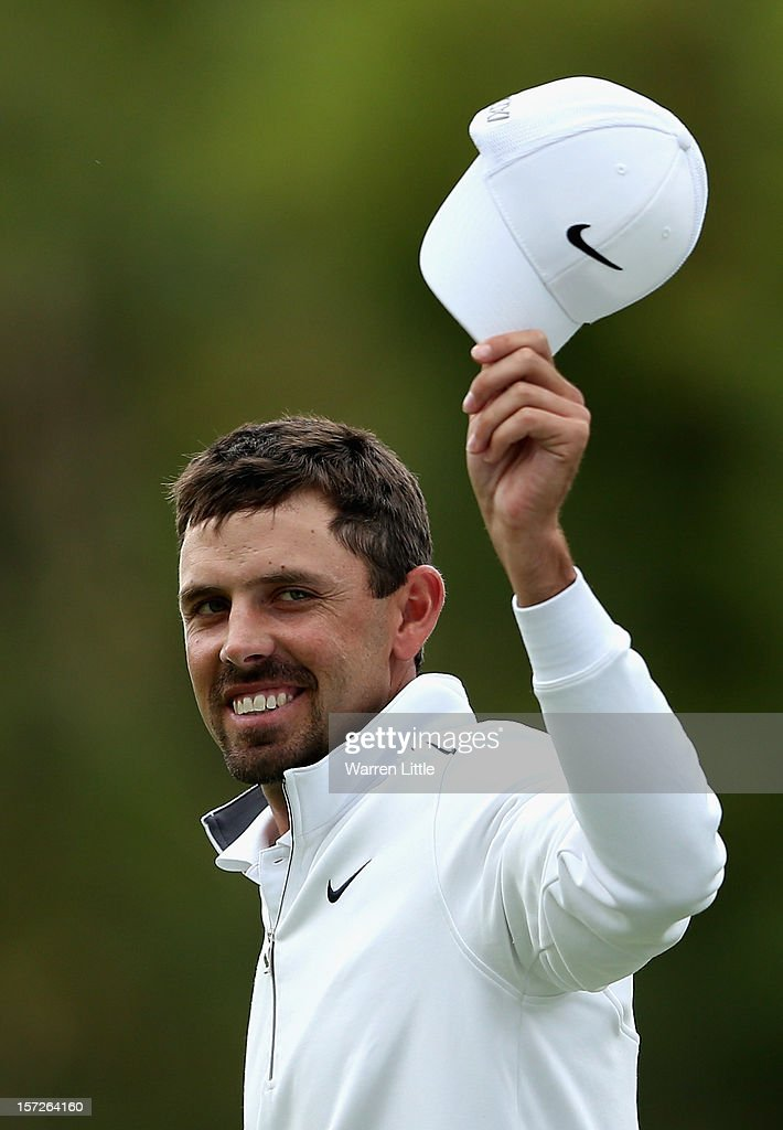 Charl Schwartzel of South Africa acknowledges the crowd on the 18th green during the third round of the Nedbank Golf Challenge at the Gary Player Country Club on December 1, 2012 in Sun City, South Africa.