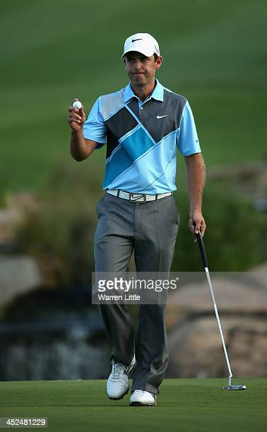 Charl Schwartzel of South Africa acknowledges the crowd on the 18th green during the second round of the Alfred Dunhill Championship at Leopard Creek...