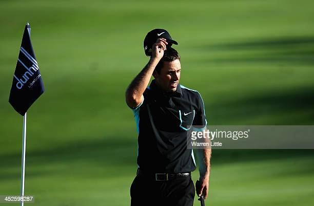 Charl Schwartzel of South Africa acknowledges the crowd on the 18th green during the third round of the Alfred Dunhill Championship at Leopard Creek...