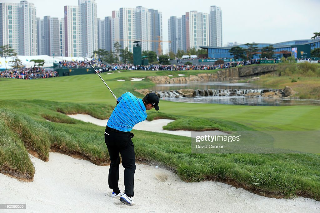 Charl Schwartzel of South Africa and the International Team fails to get his ball out of the fairway bunker for his second shot on the 18th hole in his match with Jason Day against Jordan Spieth and Dustin Johnson of the United States during the Saturday morning foursomes matches at The Presidents Cup at Jack Nicklaus Golf Club Korea on October 10, 2015 in Songdo IBD, Incheon City, South Korea.