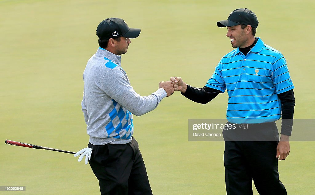 Charl Schwartzel of South Africa and the International Team congratulates his partner Jason Day of Australia after Day had holed a tricky birdie putt on the seventh hole against Jordan Spieth and Dustin Johnson of the United States during the Saturday morning foursomes matches at The Presidents Cup at Jack Nicklaus Golf Club Korea on October 10, 2015 in Songdo IBD, Incheon City, South Korea.