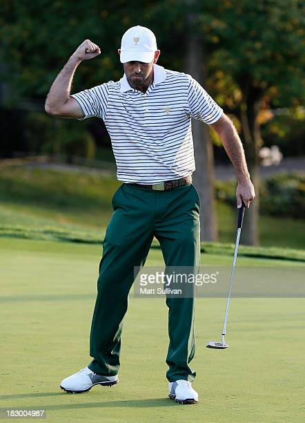 Charl Schwartzel of South Africa and the International Team makes birdie on the 17th green to defeat the team of Mickelson/Bradley 21 paired with...