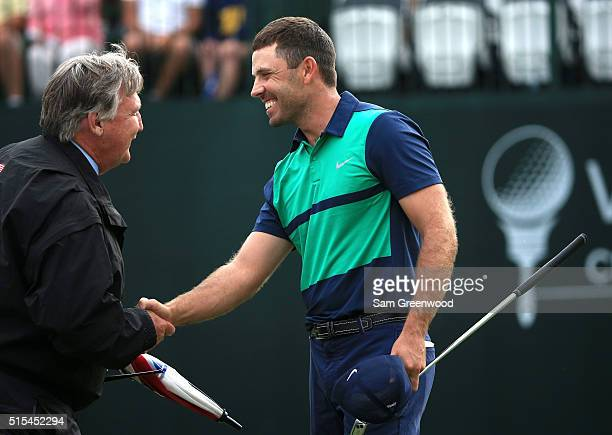 Charl Schwartzel of South Africa celebrates after a putt on the first playoff hole on the 18th green to win the Valspar Championship during the final...