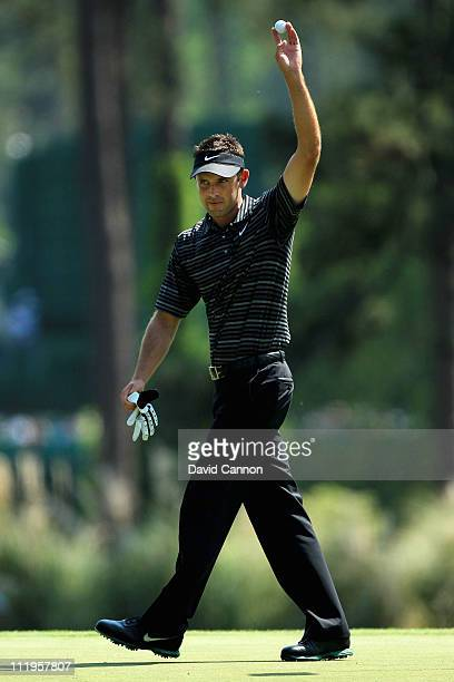 Charl Schwartzel of South Africa celebrates after holing a shot for eagle on the third green during the final round of the 2011 Masters Tournament on...