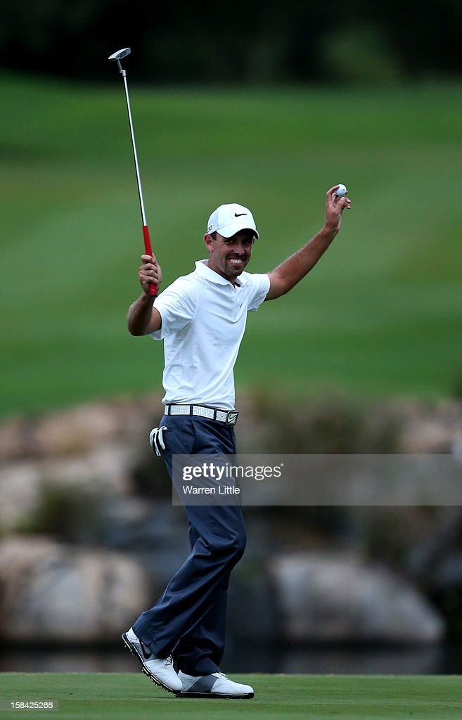 Charl Schwartzel of South Africa celebrates after winning the Alfred Dunhill Championship on a score of -24 at Leopard Creek Country Golf Club on December 16, 2012 in Malelane, South Africa.