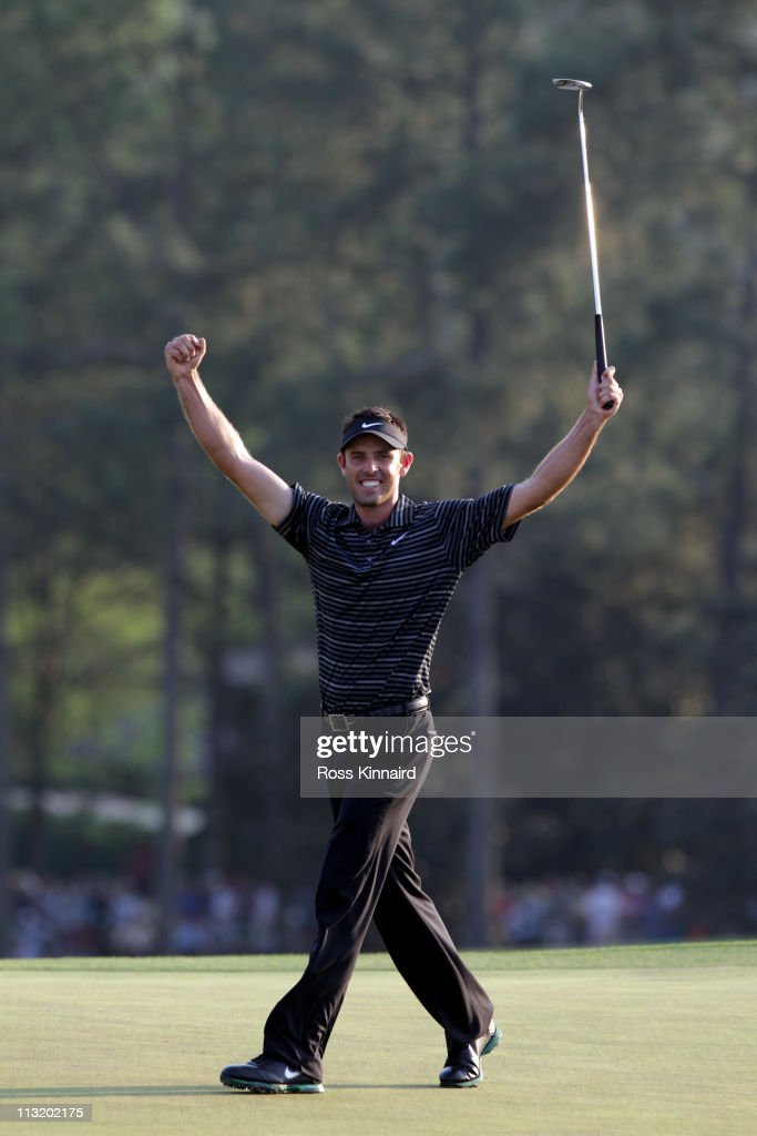 Charl Schwartzel of South Africa celebrates his birdie on the 18th green and winning the Masters during the final round of the 2011 Masters Tournament at Augusta National Golf Club on April 10, 2011 in Augusta, Georgia.