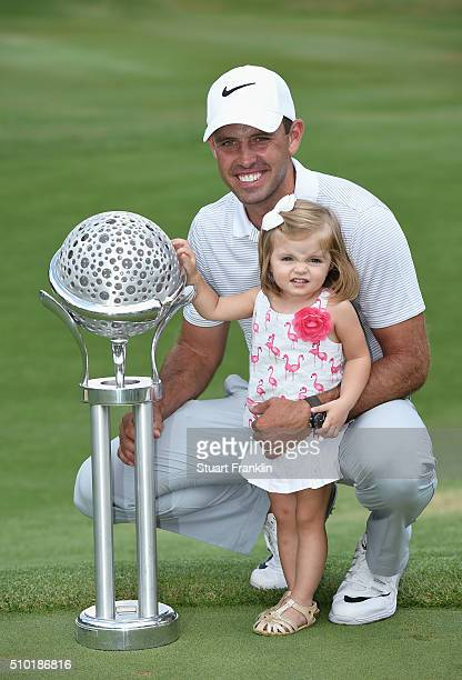 Charl Schwartzel of South Africa celebrates victory with his daughter and the trophy after the final round of the Tshwane Open at Pretoria Country...
