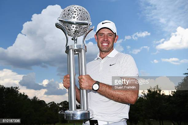 Charl Schwartzel of South Africa celebrates victory with the trophy after the final round of the Tshwane Open at Pretoria Country Club on February 14...
