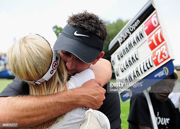 Charl Schwartzel of South Africa celebrates with his girlfriend Rosalind Jacobs after winning the Joburg Open at Royal Johannesburg and Kensington...