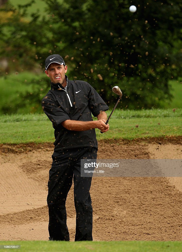 Charl Schwartzel of South Africa chips in out of the 13th greenside bunker for birdie during the fourth round of the Joburg Open at Royal Johannesburg and Kensington Golf Club on January 16, 2011 in Johannesburg, South Africa.