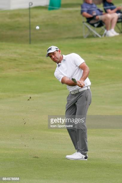 Charl Schwartzel of South Africa chips onto the 18th green during the first round of the ATT Byron Nelson on May 18 2017 at the TPC Four Seasons...