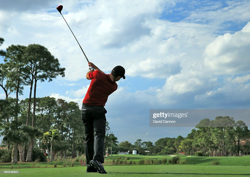 Charl Schwartzel of South Africa drives from the second tee watched by his caddie John McLaren during the first round of The Honda Classic on the Champions Course at the PGA National Resort and Spa on February 26, 2015 in Palm Beach Gardens, Florida.