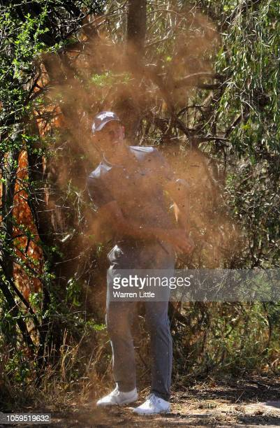 Charl Schwartzel of South Africa eventually plays out of the trees on the 15th hole after taking numerous shots eventually making a 10 during the...