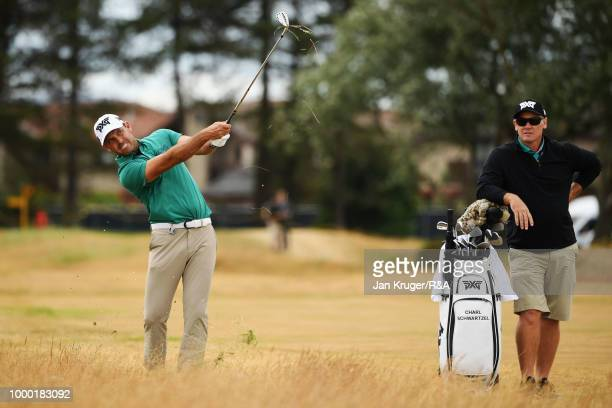 Charl Schwartzel of South Africa hits an approach on the 10th hole during previews to the 147th Open Championship at Carnoustie Golf Club on July 16...