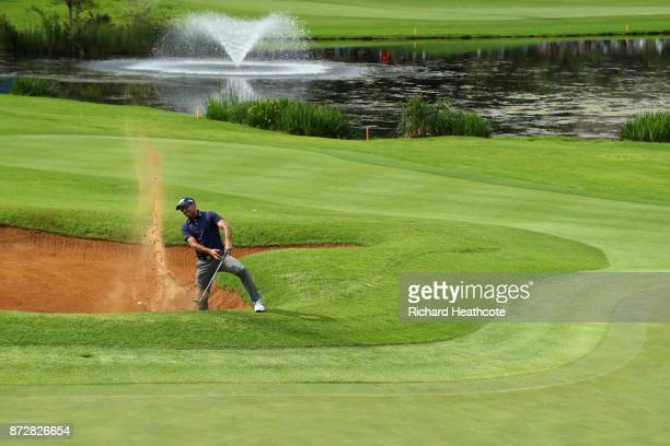 Charl Schwartzel of South Africa hits from a bunker on the 18th hole during the third round of the Nedbank Golf Challenge at Gary Player CC on...