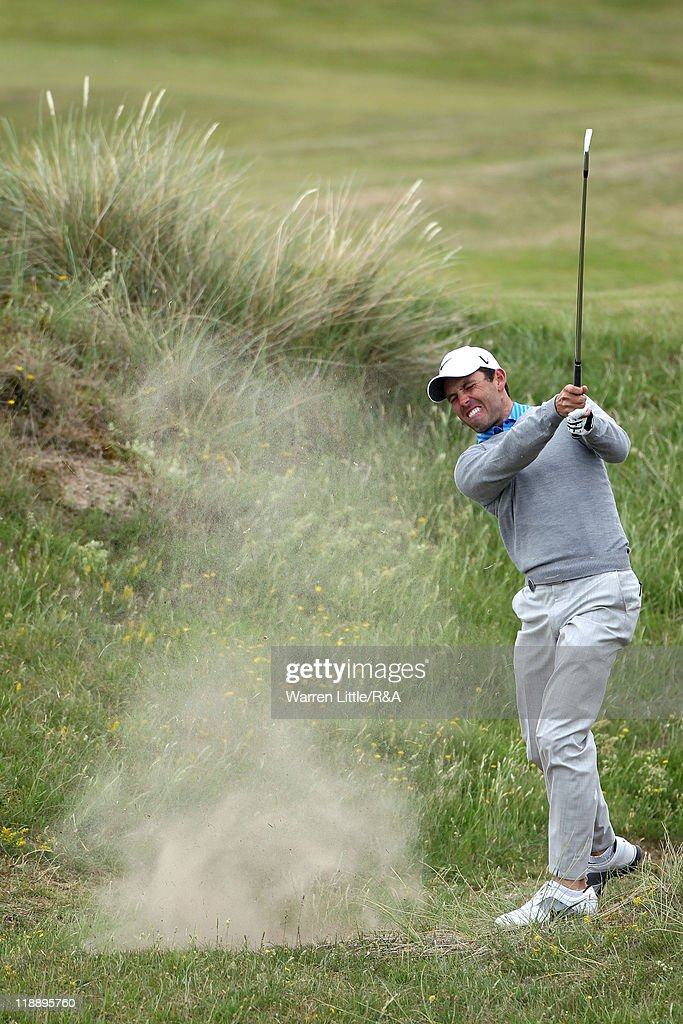 Charl Schwartzel of South Africa hits from the rough during the second practice round during The Open Championship at Royal St. George's on July 12, 2011 in Sandwich, England. The 140th Open begins on July 14, 2011.