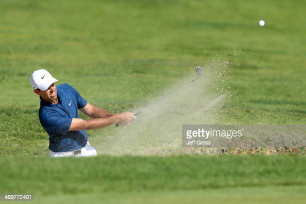 Charl Schwartzel of South Africa hits out of a bunker in the final round of the Northern Trust Open at the Riviera Country Club on February 16 2014...