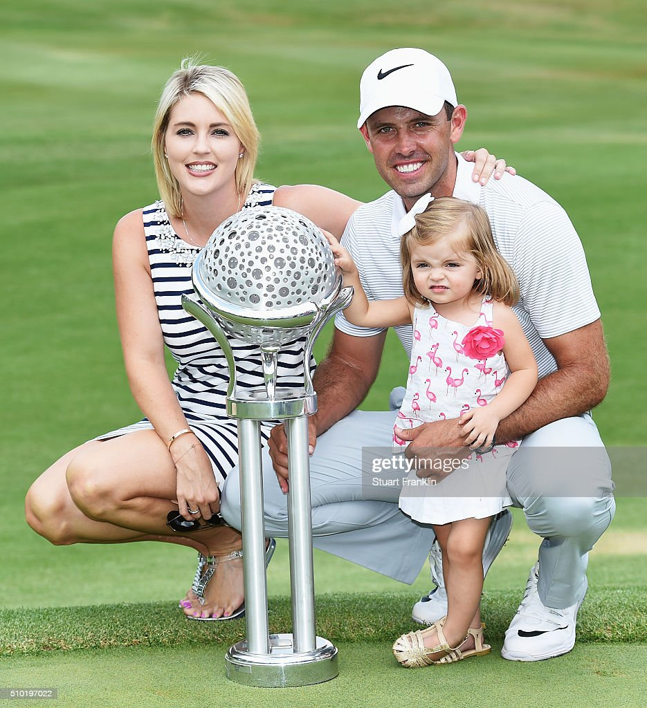 Charl Schwartzel of South Africa holds the winners trophy with his wife Rosalind Schwartzel and daughter Olivia Schwartzel after the final round of the Tshwane Open at Pretoria Country Club on February 14, 2016 in Pretoria, South Africa.