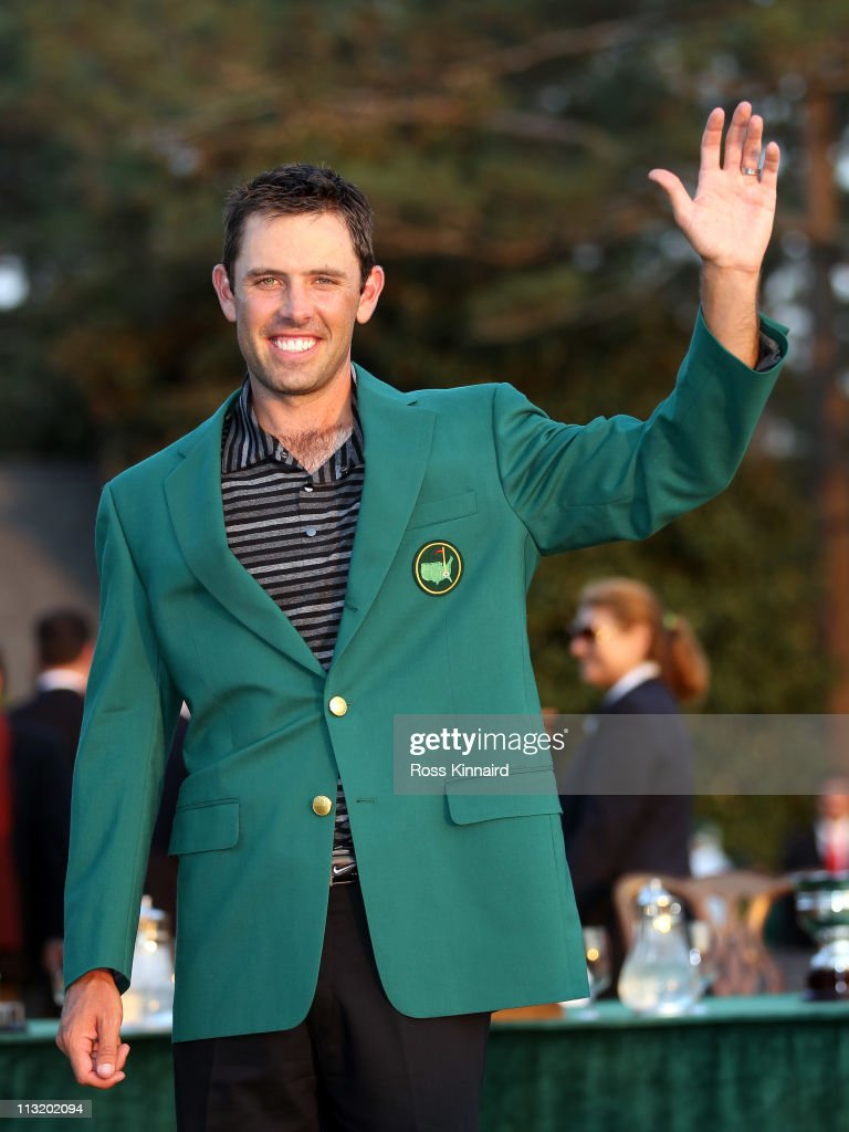 Charl Schwartzel of South Africa is presented with his Green Jacket after winning the Masters after the final round of the 2011 Masters Tournament at Augusta National Golf Club on April 10, 2011 in Augusta, Georgia.