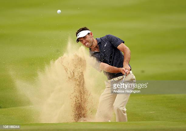 Charl Schwartzel of South Africa plays a bunker shot on the eighth hole during the first round of The Abu Dhabi HSBC Golf Championship at Abu Dhabi...