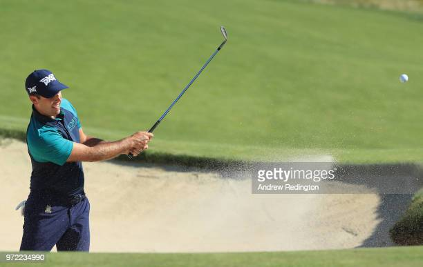 Charl Schwartzel of South Africa plays a shot from a bunker during a practice round prior to the 2018 US Open at Shinnecock Hills Golf Club on June...