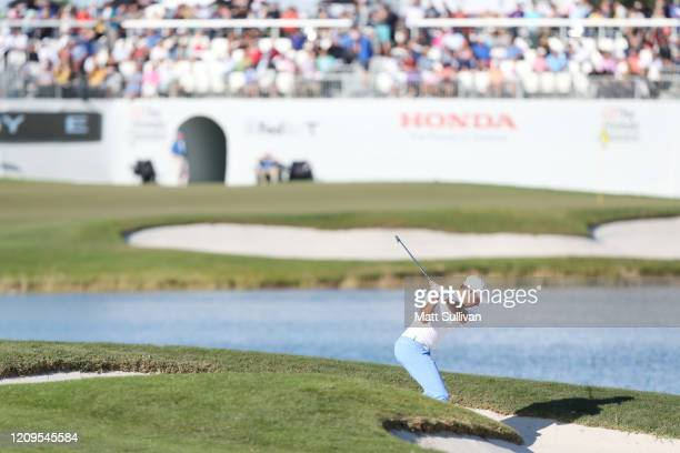 Charl Schwartzel of South Africa plays a shot from a bunker on the 16th hole during the third round of the Honda Classic at PGA National Resort and...