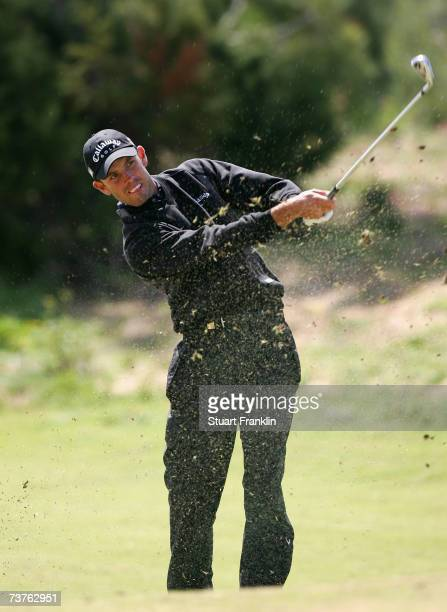 Charl Schwartzel of South Africa plays his approach shot on the eighth hole during the final round of The Estoril Open de Portugal at The Quinta da...