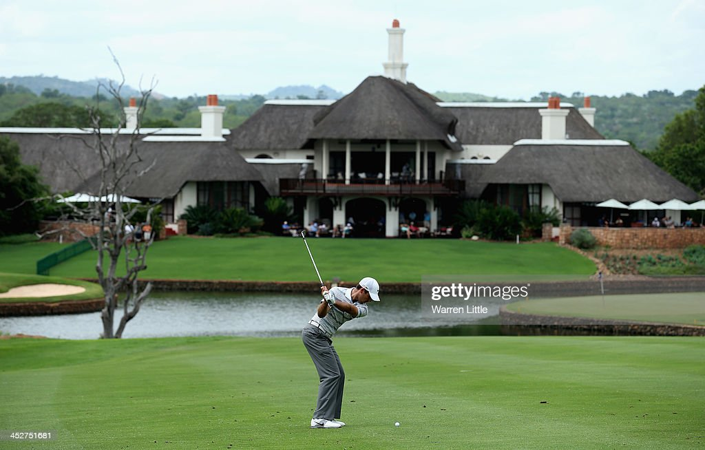 Charl Schwartzel of South Africa plays his second shot into the ninth green during the final round of the Alfred Dunhill Championship at Leopard Creek Country Club on December 1, 2013 in Malelane, South Africa.