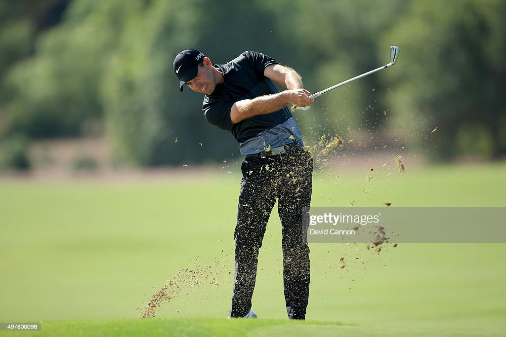 Charl Schwartzel of South Africa plays his second shot on the par 4, third hole during the first round of the 2015 DP World Tour Championship on the Earth Course at Jumeirah Golf Estates on November 19, 2015 in Dubai, United Arab Emirates.