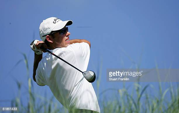 Charl Schwartzel of South Africa plays his tee shot on the 14th hole during the final round of The Dunhill Golf Championships on December 12, 2004 at...