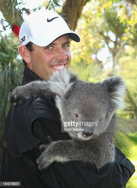 Charl Schwartzel of South Africa poses with a Koala after completing his first round during day one of the Perth International at Lake Karrinyup...