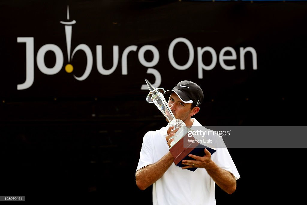 Charl Schwartzel of South Africa poses with the trophy after winning the Joburg Open at Royal Johannesburg and Kensington Golf Club on a score of -19 under par on January 16, 2011 in Johannesburg, South Africa.
