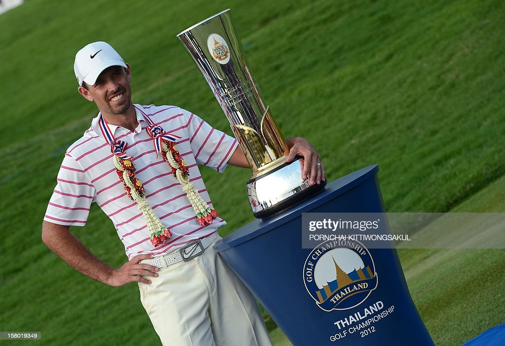 Charl Schwartzel of South Africa poses with the trophy after winning the Thailand Golf Championship at Amata Spring Country Club in Chonburi province on December 9, 2012. Schwartzel finished at 25 under-par total 263.