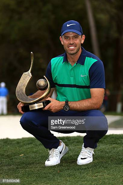 Charl Schwartzel of South Africa poses with the trophy after winning the Valspar Championship during the final round at Innisbrook Resort Copperhead...
