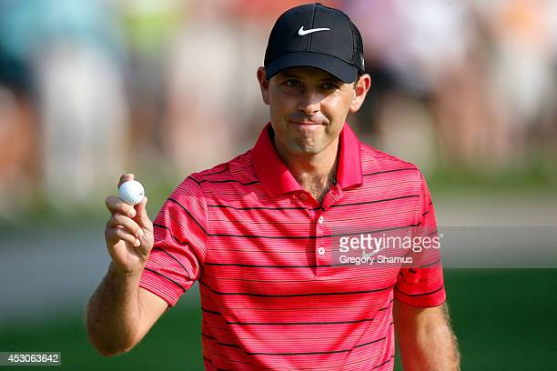 Charl Schwartzel of South Africa reacts after a putt on the first green during the third round of the World Golf ChampionshipsBridgestone...